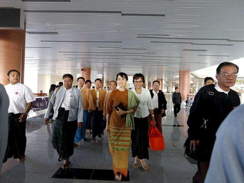 Myanmar's pro-democracy leader Aung San Suu Kyi arrives to register her National League for Democracy (NLD) party at the newly opened Naypyitaw International Airport in Naypyitaw.