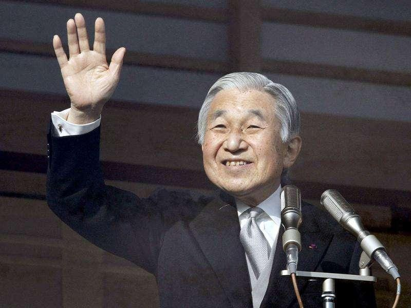 Japan's Emperor Akihito waves to well-wishers as he celebrates his 78th birthday at the Imperial Palace in Tokyo.