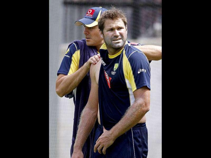 Ryan Harris of Australia gets some physiotherapy on his shoulder during training at the MCG in Melbourne, Australia.