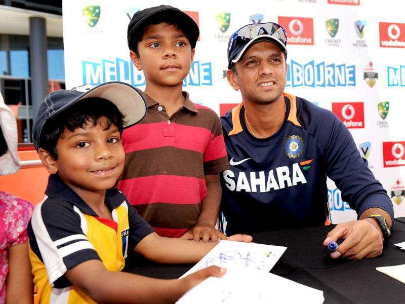 Cricketer Rahul Dravid (R) poses with fans as members of the Indian and Australian teams meet the public at an event in Melbourne. AFP Photo/William West