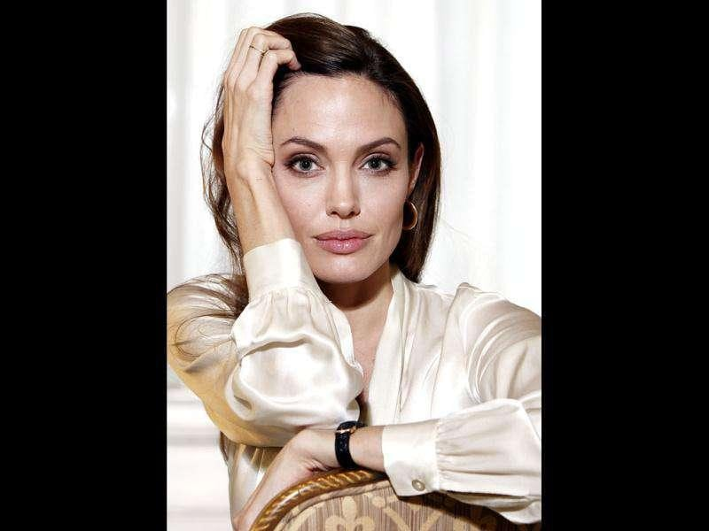 Actress Angelina Jolie poses for a portrait to promote her directorial debut of the film In the Land of Blood and Honey in New York. (AP Photo/Carlo Allegri, File)