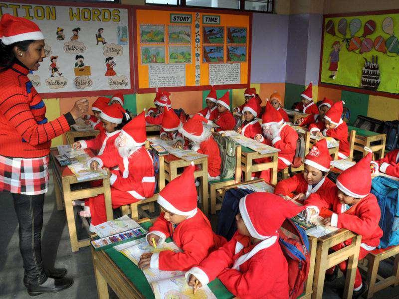 Children dress up as Santa Claus during Christmas celebration at a school in Gurgaon. HT Photo by Parveen Kumar