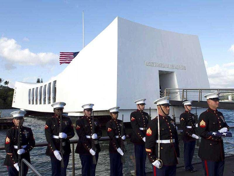 US Marines stand at attention as the family of Private First Class Frank R. Cabiness arrive at a ceremony to have his ashes interred inside the USS Arizona in Honolulu. Cabiness, who was aboard the USS Arizona when the Japanese attacked, was blown from the decks when the ship's magazine exploded. AP Photo/Marco Garcia