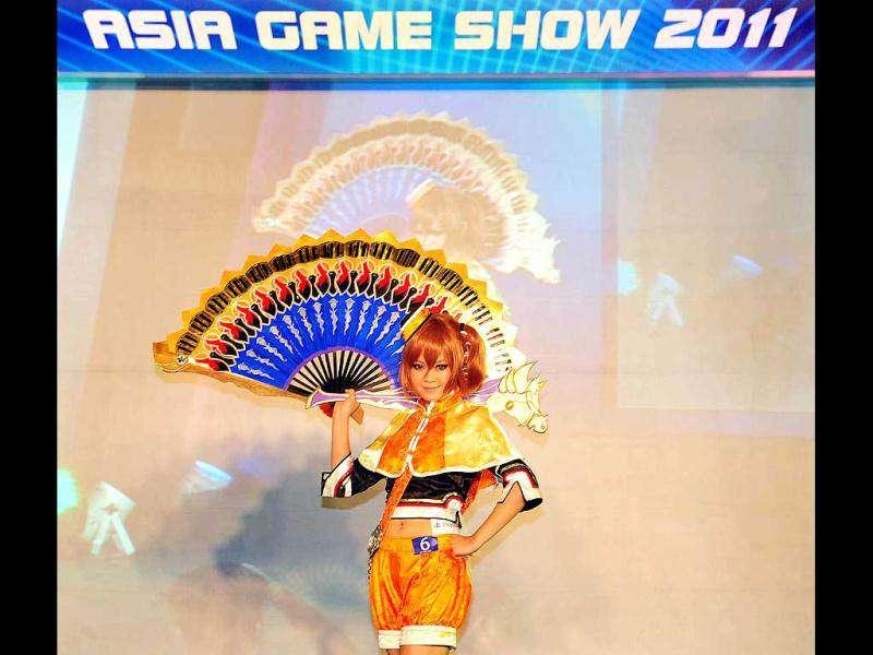 A girl dressed in cosplay strikes a pose during the 10th Asia Game Show 2011 in Hong Kong. Cosplay, short for