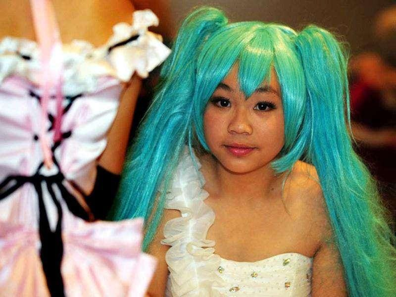 A girl dressed in cosplay poses during the 10th Asia Game Show 2011 in Hong Kong. Cosplay, short for