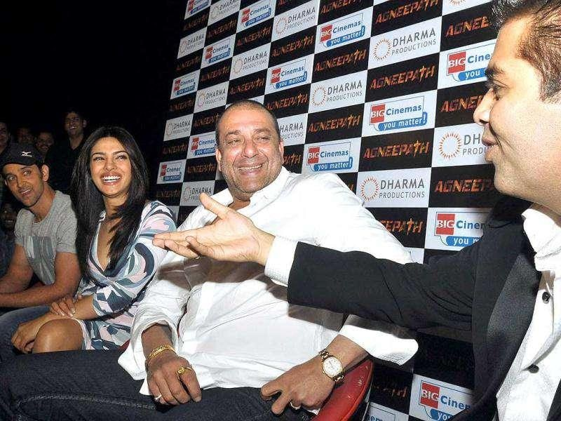 Hrithik Roshan, Priyanka Chopra and Sanjay Dutt react as director and producer Karan Johar talks at Agneepath trailer launch. (AFP)