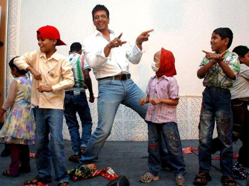 Bollywood actor Javed Jafri dancing with cancer-affected children during an event to celebrate Christmas at a hospital in Mumbai.