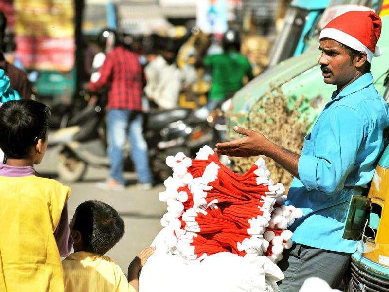 A vendor sells Santa caps at a roadside stall in Bangalore. People celebrate Christmas and the birthday of Jesus Christ on December 25.