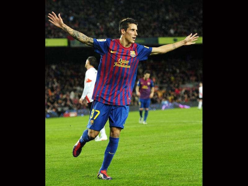 FC Barcelona Tello (R) reacts after scoring against Hospitalet during a Spanish Copa del Rey soccer match at the Camp Nou stadium, in Barcelona, Spain. AP Photo/Manu Fernandez