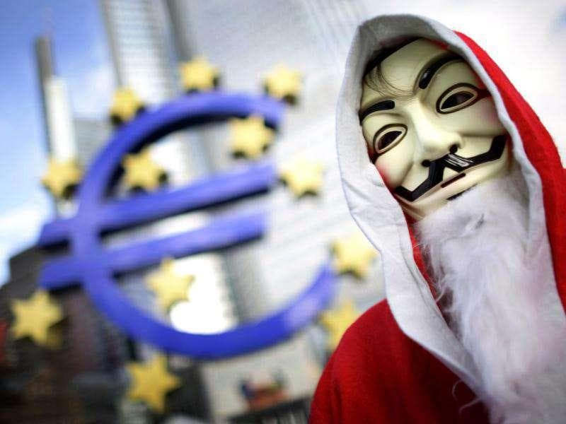 A protester of the occupy movement wears a Santa Claus costume as he walks through the occupy camp next to the euro sculpture outside the European Central Bank (ECB) headquarters in Frankfurt's banking district. Only a few protesters are left at the occupy camp over the Christmas holidays but others promised to return after spending Christmas evening with their families. Reuters/Kai Pfaffenbach