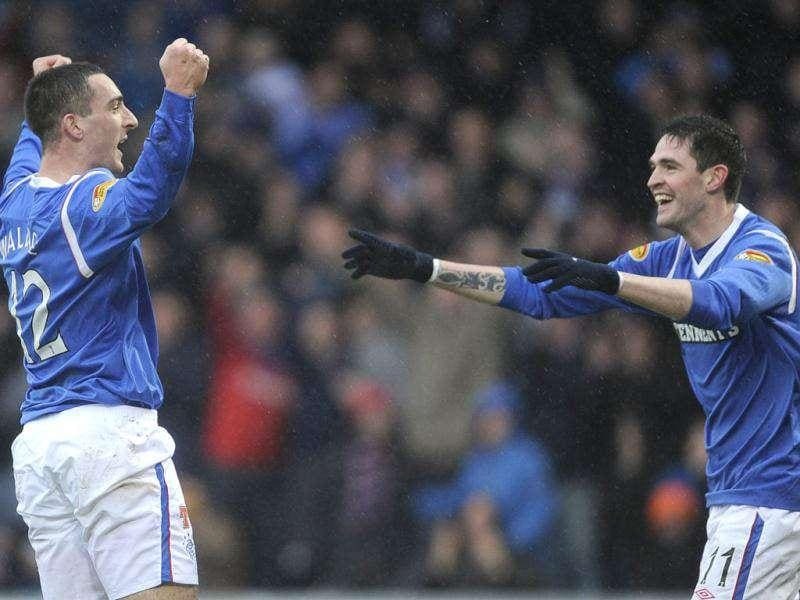 Rangers' Lee Wallace (L) celebrates his goal with Kyle Lafferty during their Scottish Premier League soccer match against St Mirren at New St Mirren Park, Paisley, Scotland. Reuters/Russell Cheyne