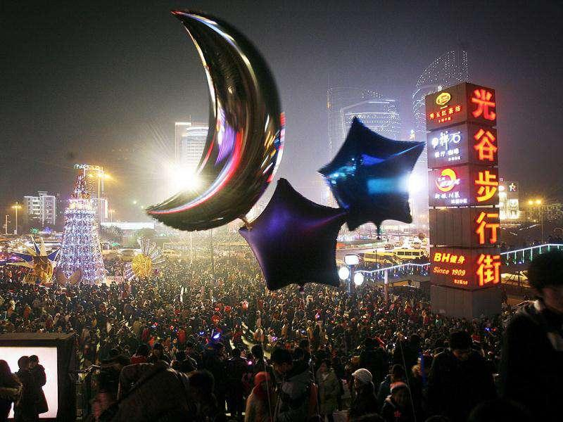 Chinese people crowd a square near a shopping district for the Christmas eve celebration in Wuhan in central China's Hubei province. AP Photo