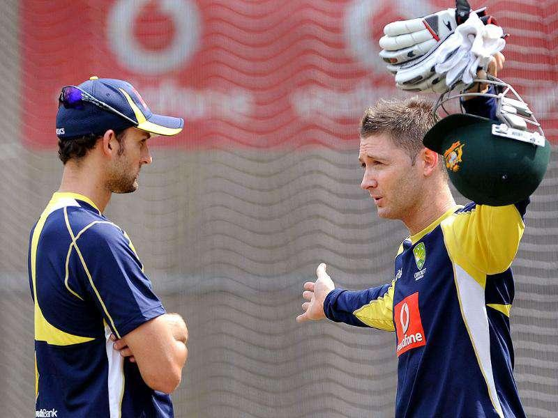 Australian captain Michael Clarke (R) talks to spinner Nathan Lyon (L) as the team trains for their upcoming Test match against India at the Melbourne Cricket Ground. AFP Photo/William West