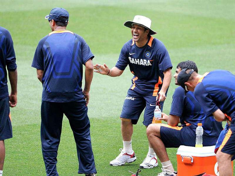 Sachin Tendulkar (3rd-R) shares a joke with teammates during their training the upcoming Test match against Australia at the Melbourne Cricket Ground. AFP Photo/William West
