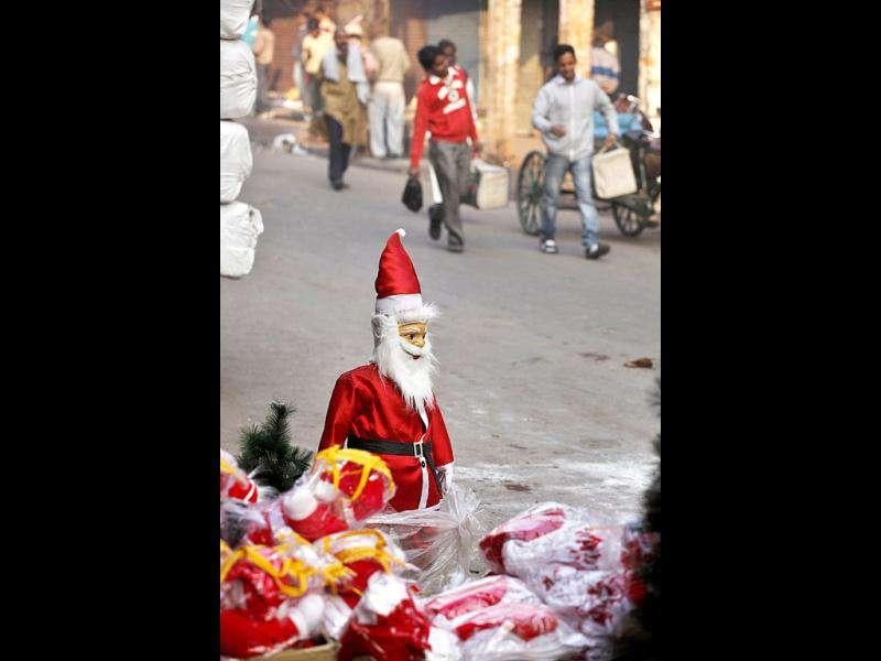 Figures of Santa Claus and other Christmas decorations are displayed for sale at a shop in New Delhi.