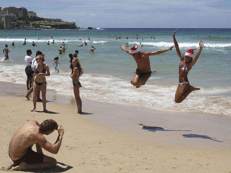 Beach goers jump in the air for a photo as they celebrate on Christmas Day at Bondi Beach in Sydney, Australia. AP Photo
