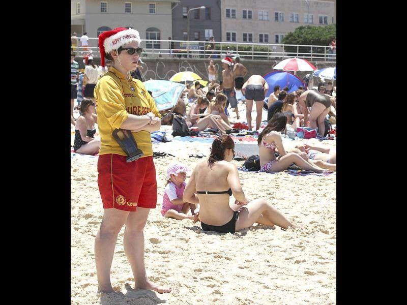 A lifeguard wearing Santa hat keeps watch on Christmas Day at Bondi Beach in Sydney. AP Photo