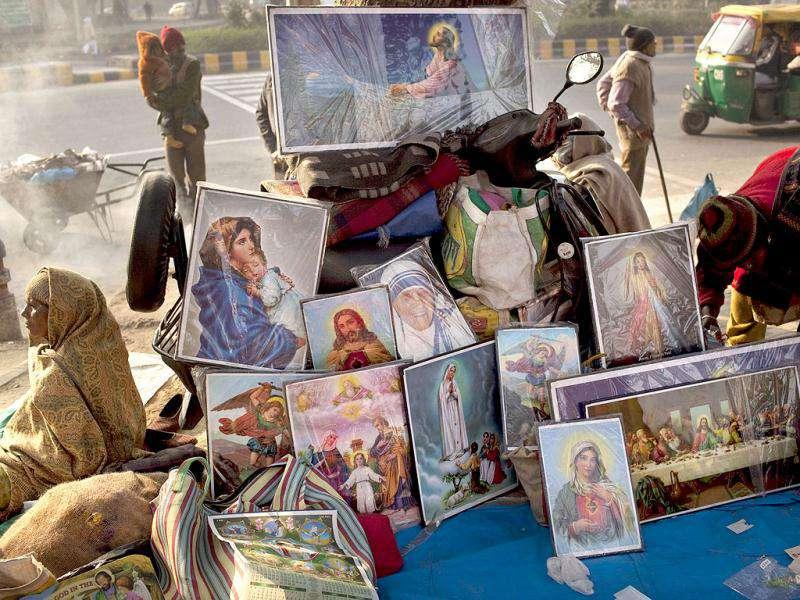 A street vendor sells posters and pictures in a market at the Sacred Heart's Cathedral on Delhi's coldest Christmas in five years.