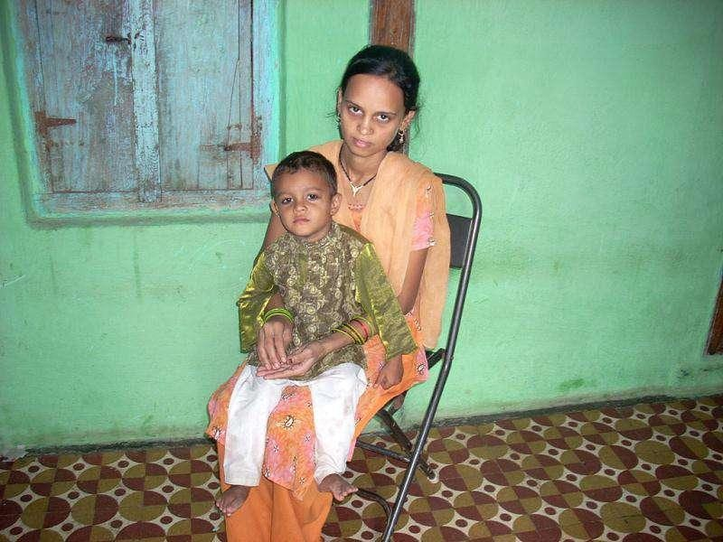 Parveen Sheikh and her son Rehan pose for a photograph in Ellora village, which lies some four hundred kilometres north-east of Mumbai in Aurangabad division. The Rajmata Jijau nutrition mission helped save Rehan. Thousands of mothers in Maharashtra are grateful to the mission and its work for saving the lives of their children. HT Photo