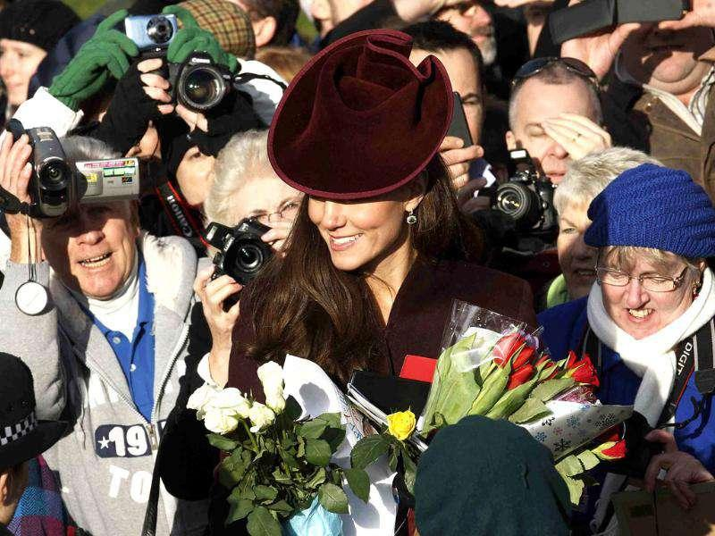 Britain's Catherine, Duchess of Cambridge greets well-wishers after leaving a Christmas Day service at St Mary Magdalene Church on the Royal estate at Sandringham, Norfolk in east England. Reuters/Suzanne Plunkett.