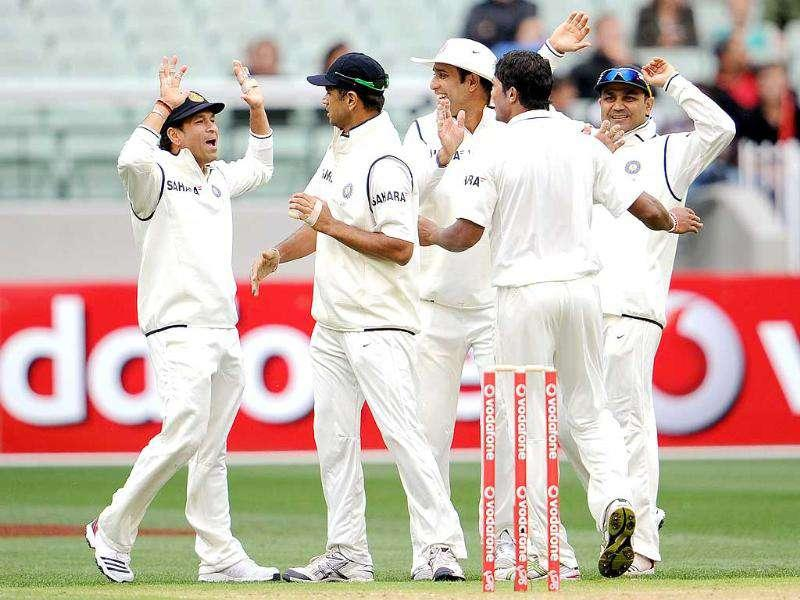 Sachin Tendulkar, Rahul Dravid, VVS Laxman and Virender Sehwag congratulate paceman Umesh Yadav after he dismissed Australian batsman David Warner on the first day of the first Test match at the Melbourne Cricket Ground (MCG), in Melbourne.