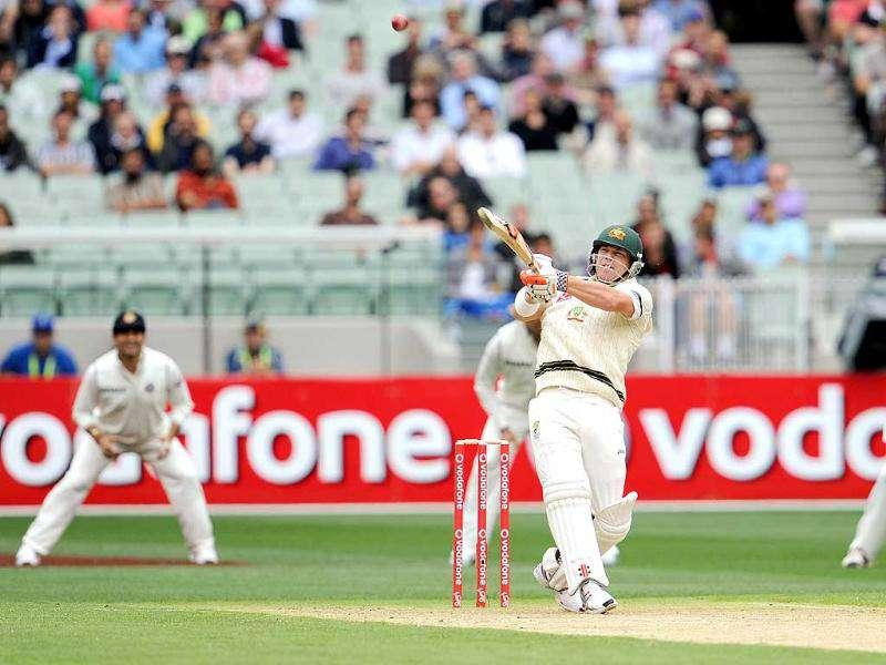 Australian batsman David Warner hooks a ball away on the first day of their first Test match against India at the Melbourne Cricket Ground (MCG), in Melbourne. AFP Photo