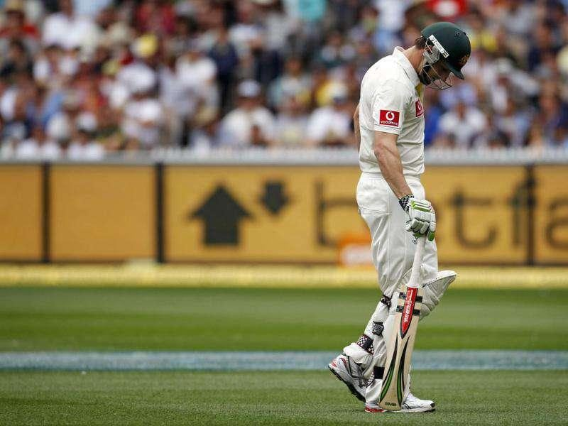 Australia's Shaun Marsh reacts as he leaves the field after being dismissed by Umesh Yadav during the first day of the first cricket Test match, at the Melbourne Cricket Ground. Reuters Photo