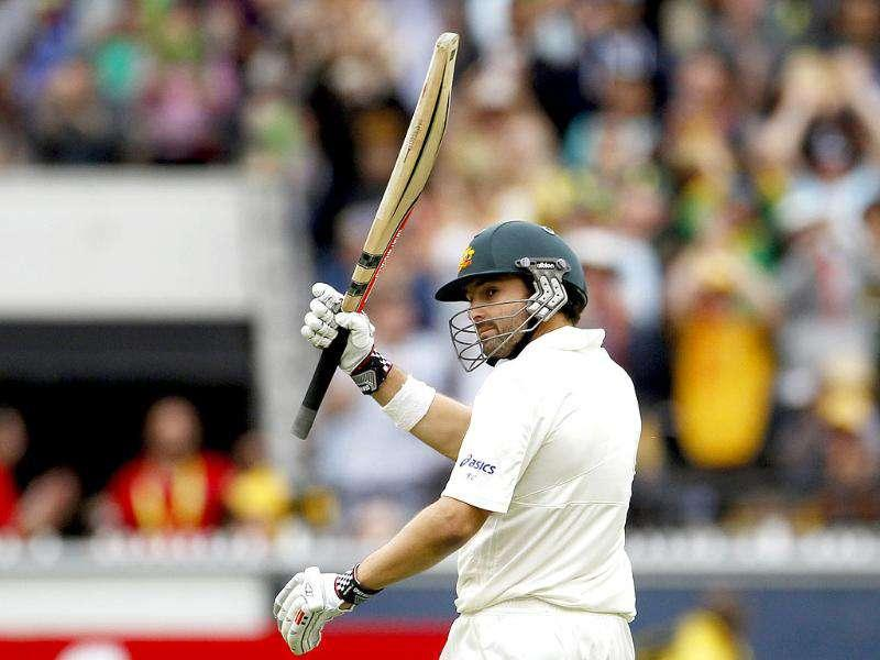 Australia's Ed Cowan acknowledges spectators after reaching his half century against India during the first day of the first cricket Test match, at the Melbourne Cricket Ground. Reuters Photo