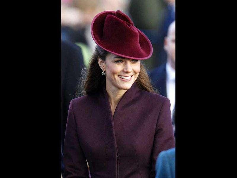 Kate Middleton wore a long coat in berry with an elegant hat on her first Christmas ceremony in England. The Duchess took the show as she glows and beams. Raising a toast to the lady's style!