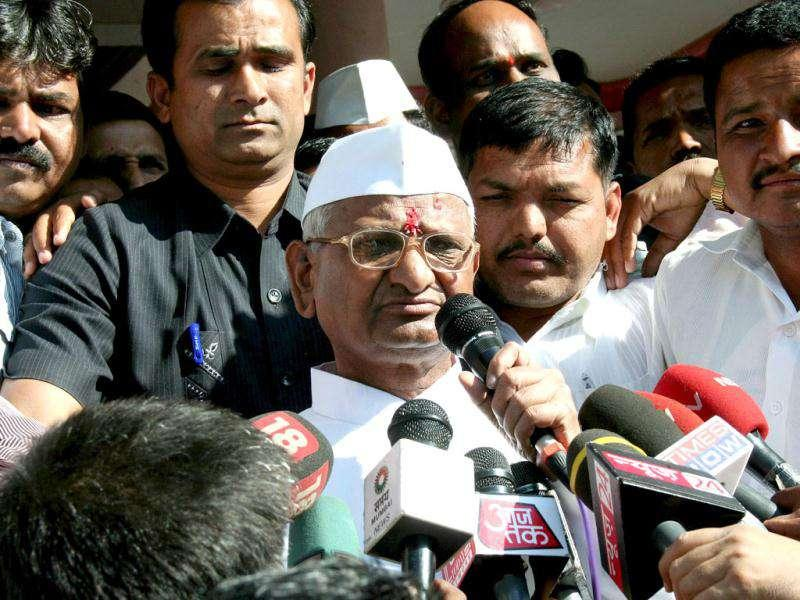 Anna Hazare speaks to the media as he leaves, for a 3 day-long fast in Mumbai, his home in Ralegan Siddhi. AFP Photo