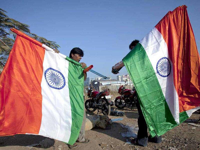 Two men carrying the tri-colour gather outside the venue of Anna Hazare's three-day fast at MMRDA ground in Mumbai. Reuters Photo