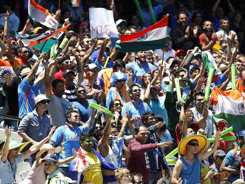 Indian fans celebrate a boundary hit by Virender Sehwag during the first cricket Test match against Australia, at the Melbourne Cricket Ground. Reuters Photo