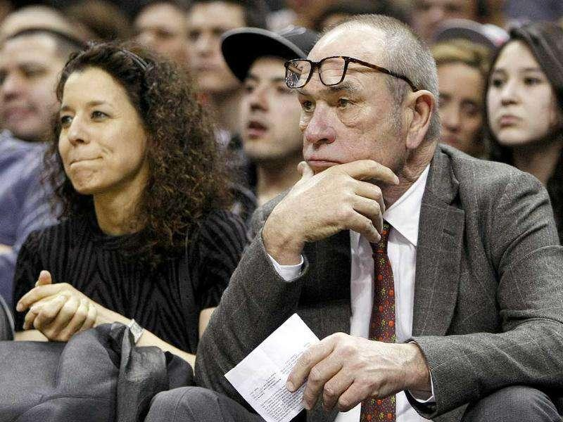 Actor Tommy Lee Jones watches an NBA basketball game between the Memphis Grizzlies and the San Antonio Spurs in San Antonio. AP Photo