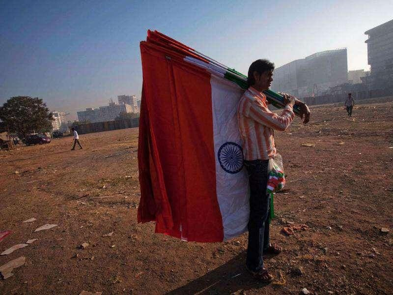 A man selling national flags stands outside the venue of Anna Hazare's three-day fast at the MMRDA grounds in Mumbai. Reuters Photo