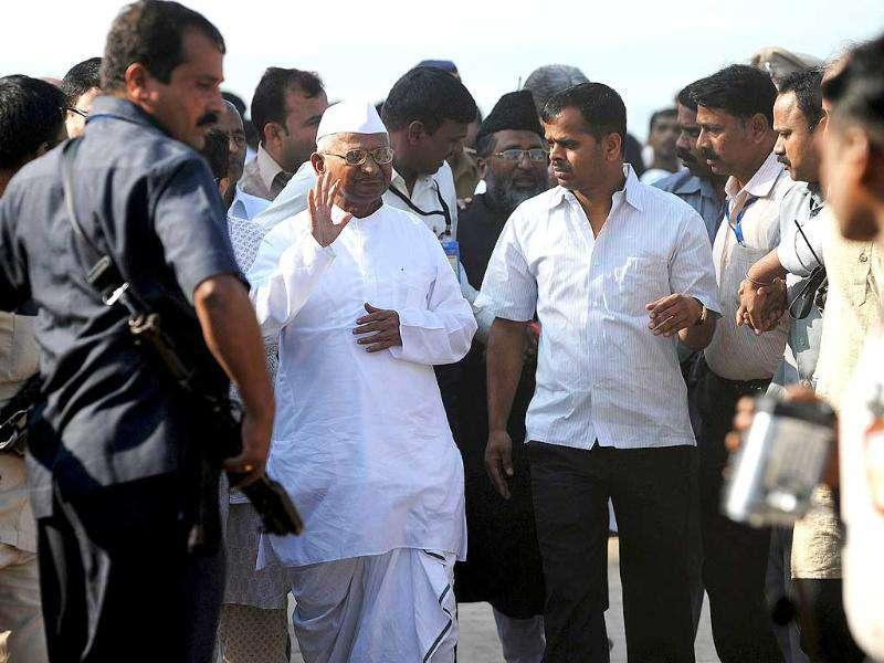 Anna Hazare leaves after paying respects to Father of The Nation Mahatma Gandhi before embarking to MMRDA ground for a 3 day-long fast. AFP Photo