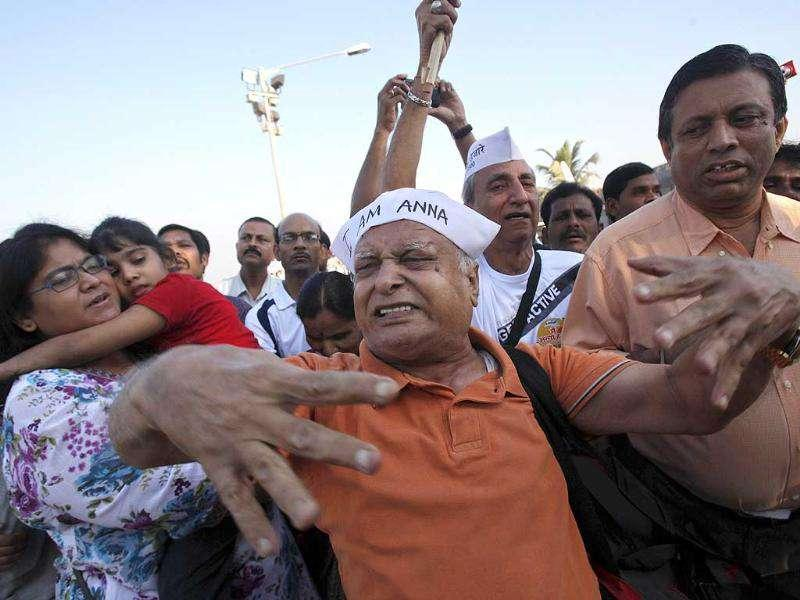 A supporter (C) of Anna Hazare shouts pro-Hazare slogans at the Mahatma Gandhi memorial in Juhu Beach, Mumbai. Reuters Photo