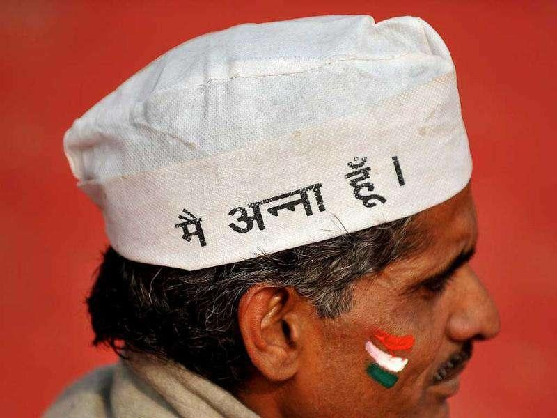 A supporter of Anna Hazare wears an 'I am Anna' cap during a rally in Ramlila Ground in New Delhi. AFP Photo