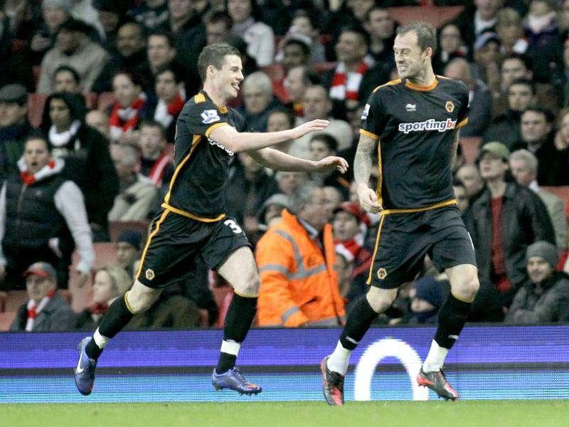 Arsenal's Wolverhampton Wanderers' Steven Fletcher (R) celebrates his goal against Arsenal with teammate Anthony Forde during their English Premier League soccer match at Emirates Stadium, London. (AP Photo/Sang Tan)