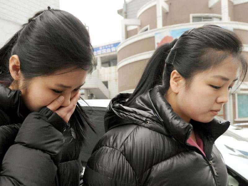 North Korean mourners leave a Korean restaurant after watching a telecast of the funeral of the late leader Kim Jong-Il, at the North Korean and Chinese border town of Dandong. North Korea on December 28 began the funeral of late leader Kim Jong-Il, Russian media reported from a snowy Pyongyang, as the grieving communist state bolstered his son's status as