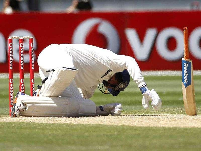 Ishant Sharma falls as he avoids a bouncer from Australian Peter Siddle during the first cricket Test match, at the Melbourne Cricket Ground. Reuters Photo