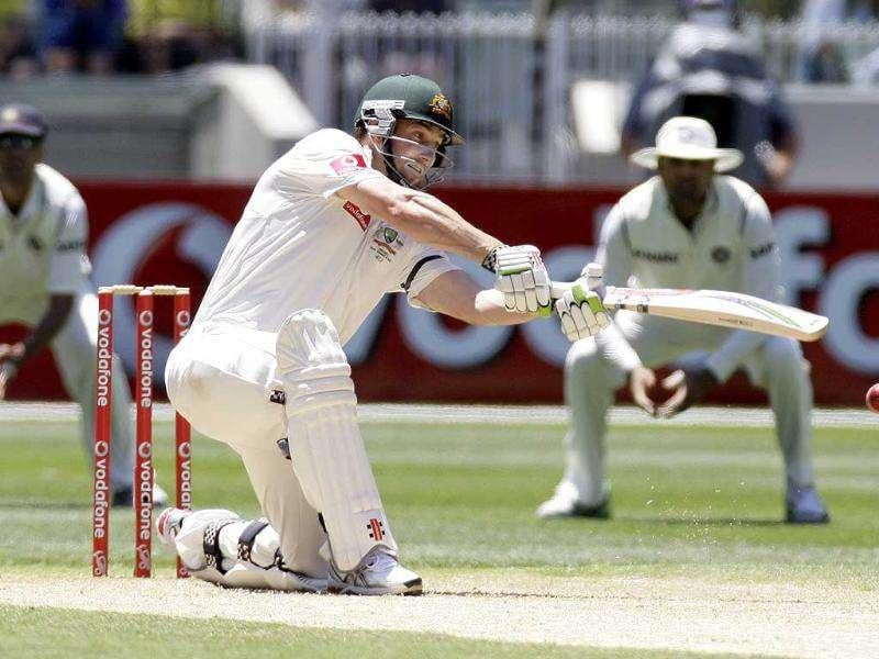 Shaun Marsh of Australia hits a shot during the third day of the first Test match against India at the MCG, Melbourne. AP Photo