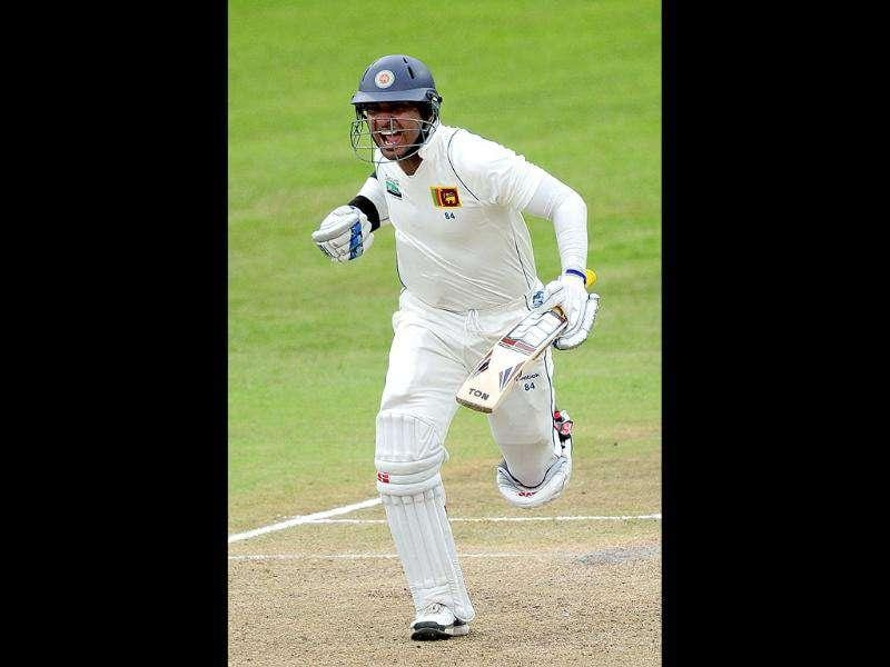 Kumar Sangakkara of Sri Lanka celebrates his century during their second Test cricket match against South Africa in Durban. (AP Photo)