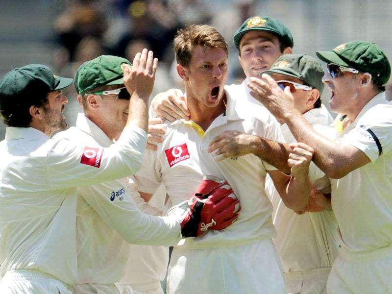 Australian paceman James Pattinson (C) celebrates with teammates after dismissing Rahul Dravid on the fourth day of the first Test match between Australian and India at the Melbourne Cricket Ground (MCG), in Melbourne.