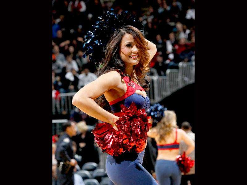An Atlanta Hawks cheerleader performs during the game against the Washington Wizards at Philips Arena in Atlanta, Georgia.