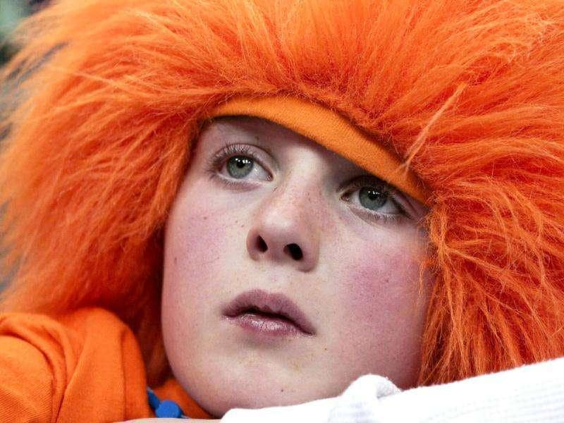 Syracuse Orange fan Cody Miller, 8, of Oneida, New York, watches his team warm up before their NCAA men's basketball game against Seton Hall Pirates in Syracuse.