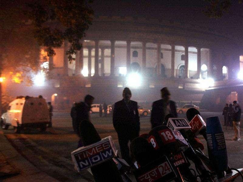 Media persons wait outside Parliament House during the discussion on Lokpal Bill in Rajya Sabha in New Delhi. PTI