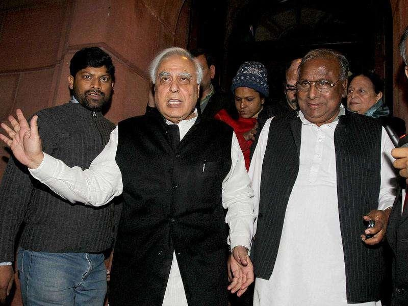 Union HRD minister Kapil Sibal and other MPs come out after discussion on Lokpal bill in Rajya Sabha in New Delhi. PTI