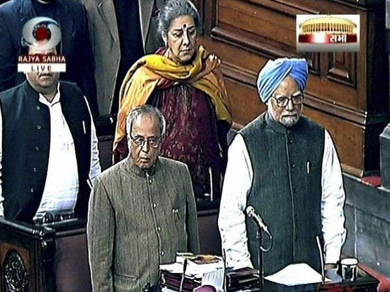 TV grab of Prime Minister Manmohan Singh, finance minister Pranab Mukherjee and other Congress leaders seen standing for the National song minutes before the Rajya Sabha was adjourned sine die. PTI