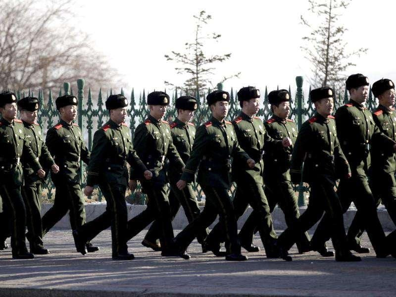 Chinese paramilitary police officers march near the customs office a day after of a memorial service for the late North Korean leader Kim Jong Il, in Dandong, a Chinese city bordering with North Korea.