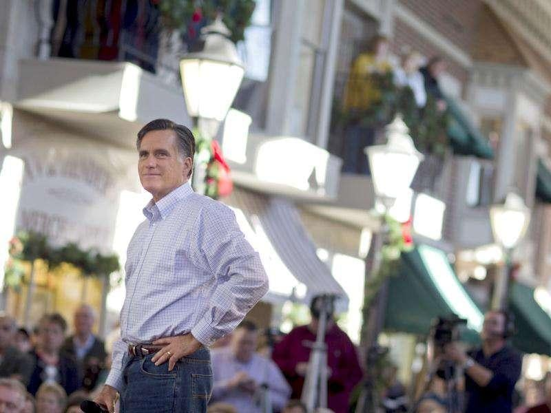 Republican presidential candidate, former Massachusetts Gov. Mitt Romney pauses during a campaign stop in Mason City, Iowa.